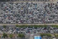 春节假期过半 海南自驾游客返程堵在海港